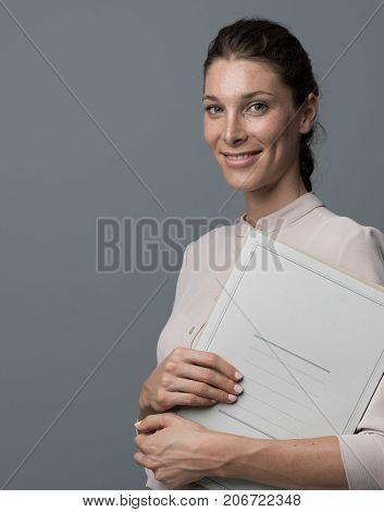 Secretary Holding A Folder