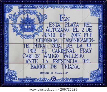 Seville Spain - November 1 2013: Blue background commemoration Mosaic in Seville suburb of Triana