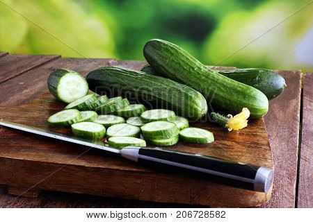 Fresh And Sliced Cucumbers. Sliced Cucumbers On A Cutting Board. Cucumbers For Diet And Healthy Eati