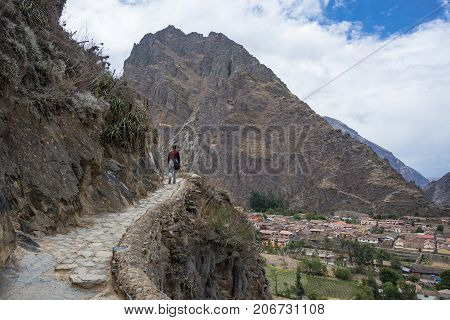 Tourist Exploring The Inca Trails And The Archaeological Site At Ollantaytambo, Sacred Valley, Trave
