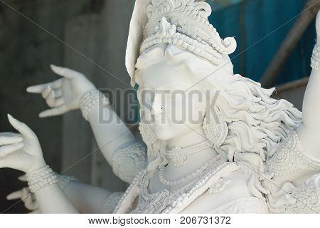 KOLKATA, WEST BENGAL, INDIA - 10 SEPTEMBER 2017: Clay idol of Goddess Durga, under preparation for Bengal's Durga Puja festival in Kumartuli, Kolkata. Durga Puja is biggest festival in West Bengal.