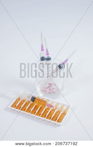 Medical Ampoule And Syringe. Vials Of Medications