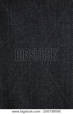 Black woven textile fabric swatch for backgrounds