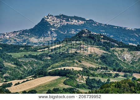 Country landscape in Romagna (Italy) from Sogliano al Rubicone at summer. View of San Marino