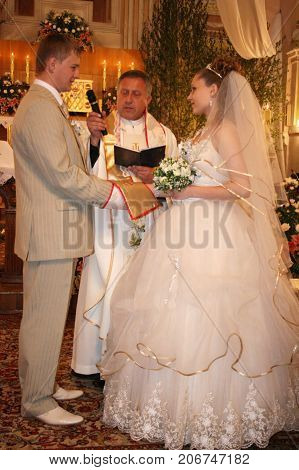 LUTSK UKRAINE - 24 May 2008: Wedding couple swear one to one at church