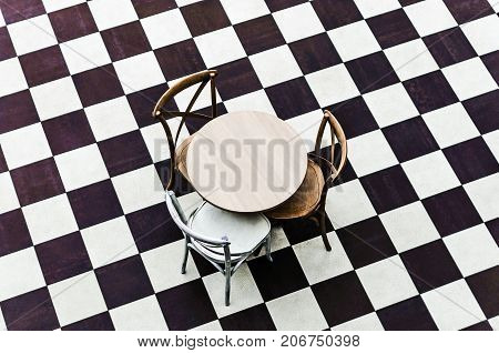modern chair for interior design and a table on a chessboard floor
