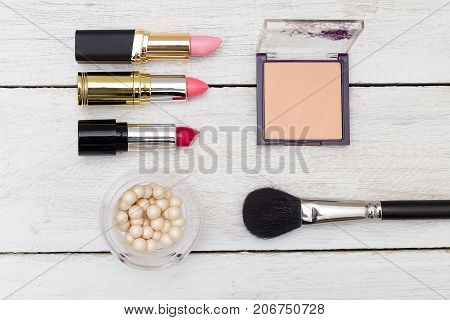 Female cosmetics lies on a wooden background. View from above