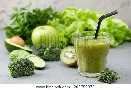 green smoothies in glassful with fresh vegetables and herbs: broccoli avocado lime celery apple kiwi parsley. detox smoothies