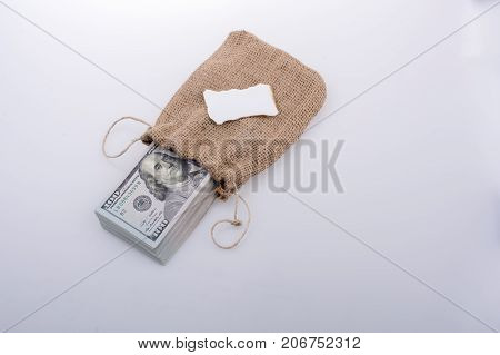 Banknote bundle of US dollarin a sack with a note paper