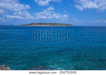blue water and sky with island in the backgound