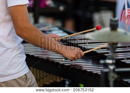 a percussionist playing a vibraphone during a rehearsal