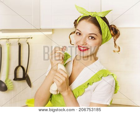 Young Housewife Cooking In Her Kitchen Room.