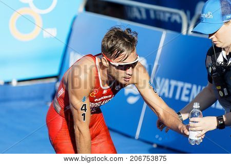 STOCKHOLM - AUG 26 2017: Triathlete Sylvain Fridelance (SUI) exhausted after the race in the Men's ITU World Triathlon series event August 26 2017 in Stockholm Sweden