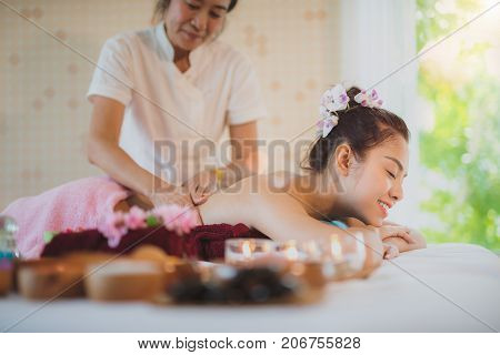 Asian lady relax in skin care aroma therapy and scrub spa in Thailand resort
