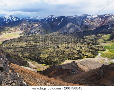 Colored mountains lava fields and thermal springs in the Landmannalaugar valley Iceland