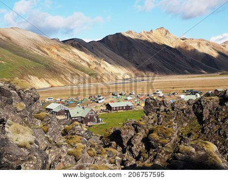 Camping on the background of the colored mountains in the Landmannalaugar valley Iceland