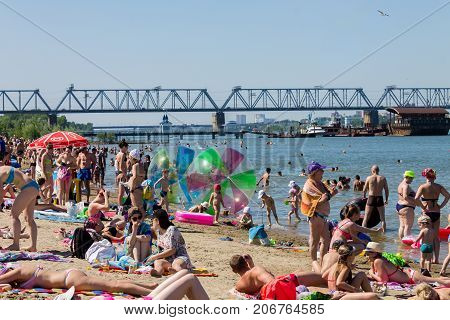 A crowded sand beach on the Ob river in Novosibirsk Russia June 2017