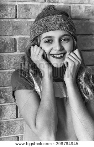 Happy Pretty Girl Smiles In Grey Beanie Hat