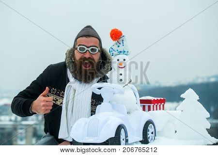 Bearded Hipster In Pilot Hat And Glasses Showing Thumbs Up
