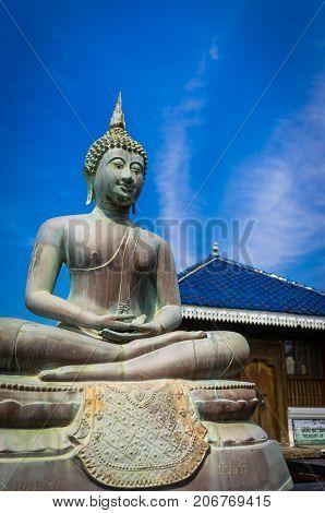 Buddha statue in Gangarama Buddhist Temple, Sri Lanka