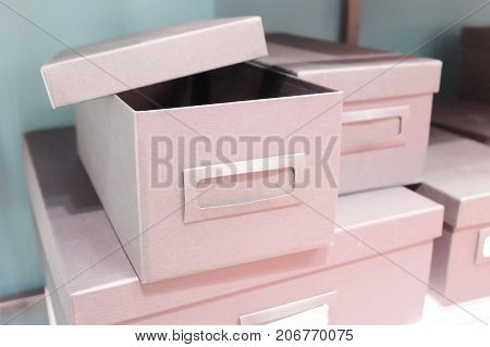 Stack of Empty Office Storage Boxes or Archive Boxes Used for Storing Paper Media and Accessories.