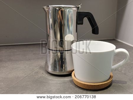 Cuisine and Food White Porcelain Cup with Coffee Pot on The Table Used for Preparing and Drinking Coffee in The Morning.