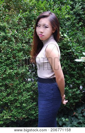 Asian female beauty fashion model expressions outdoors.