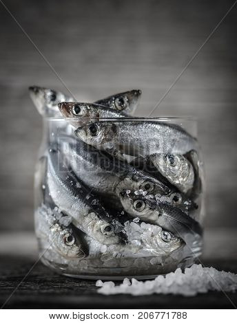 Raw Baltic Herring In A Glass Jar. The Process Of Salting Fish.