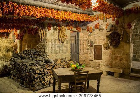 Lecce Italy - August 10 2014: Tomatoes hung to dry in a typical Apulian farmhouse.