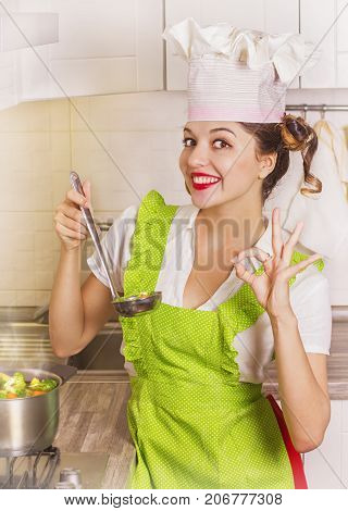 Beautiful Smiling Housewife Tasting Soup With Ladle And Pot