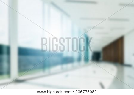 Blur background inside office hallway interior with glass wall window