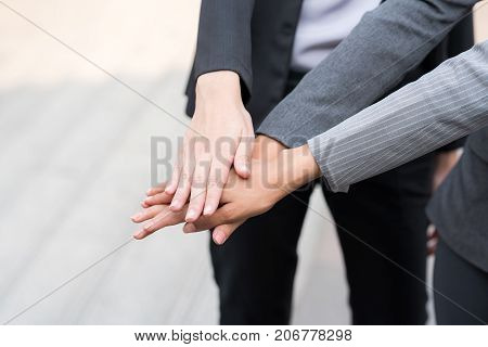 Business people join hand. Team collaboration and teamwork concept