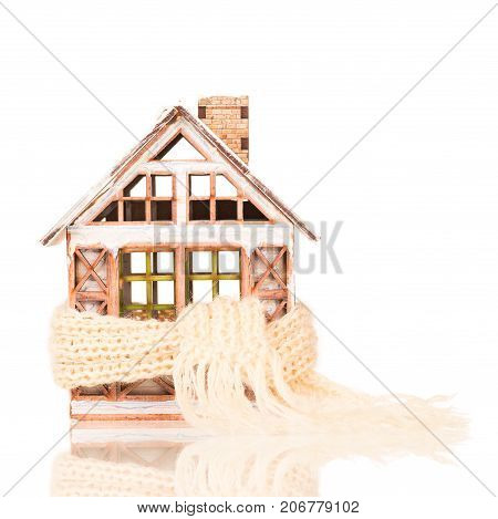Little toy house with knitted scarf isolated over white background