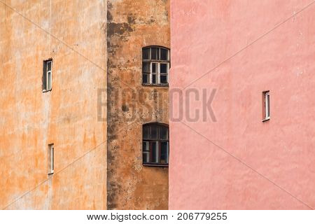 Several windows located on facades of two different urban apartment buildings chaotically St. Petersburg Russia
