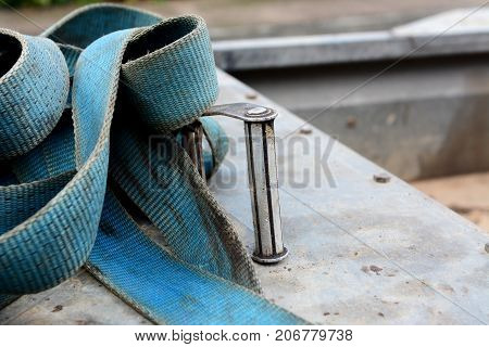 Detail Of Metal Buckle On A Blue Ratchet Strap