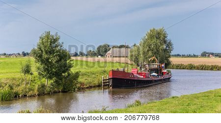 Old ship in the Reitdiep river near Aduarderzijl Netherlands