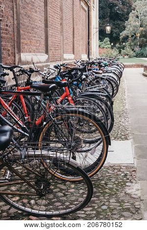 CAMBRIDGE, UK - SEPTEMBER 25, 2017: Bikes parked on the street in Cambridge. Cambridge has the highest level of cycling in the country with one in four residents cycling to work.