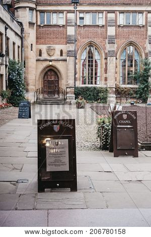 CAMBRIDGE, UK - SEPTEMBER 25, 2017: Signs in the courtyard of Pembroke College. The college is the third-oldest college of the Cambridge university and has over seven hundred students and fellows.