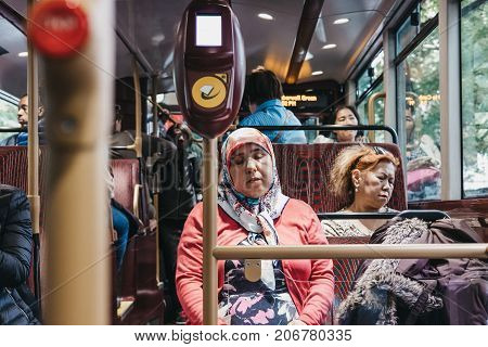 LONDON, UK - SEPTEMBER 24, 2017: Passengers inside a New Routemaster, a hybrid diesel-electric double-decker bus operated in London, UK.