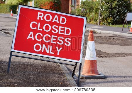 Road Closed Access Only Road Sign With A Traffic Cone