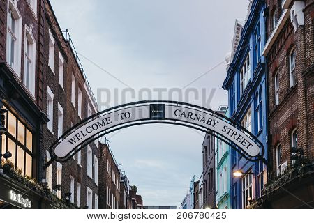 LONDON, UK - SEPTEMBER 24, 2017: Welcome to Carnaby Street Sign over Carnaby Street. Carnaby Street is a pedestrianised shopping street in Soho area of London.