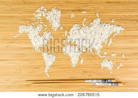 Map Of The World Made Of White Rice With Two Bamboo Sticks