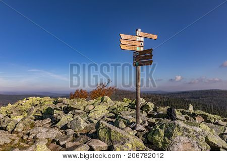 Luzny Sumava. Lusen Bavaria Germany. Tourist signpost at the top of Luzny Hill. Colorful autumn in mountain Sumava. Germany