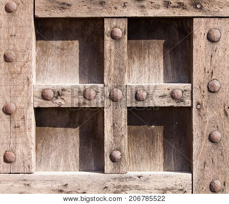 Old wooden pattern boards and metal rivets backgrounds and textures