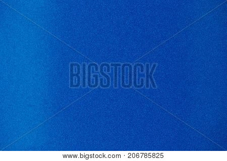 Blue abstract matte pattern background. Metal blue spark surface