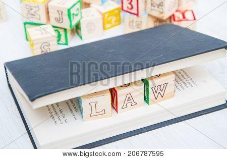 a Law written on a wooden cubes