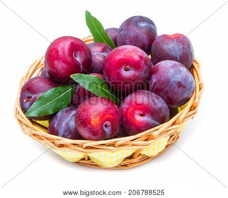 group of red plums in a basket on white background