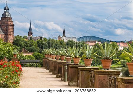 Beautiful view from Pompejanum ( Pompeiianum) - idealised replica of Roman villa to the old town Aschaffenburg Germany and the palace Johannisburg at summer cloudy day. Tourist attraction tourists destination point