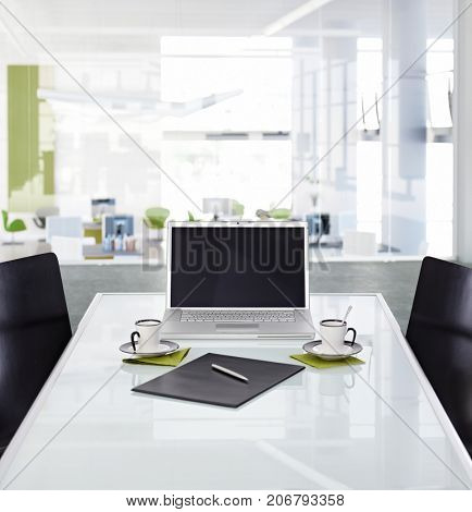 Office desk with laptop, Still life in meeting room.