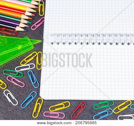 School Supplies On Black Background Ready For Your Design.